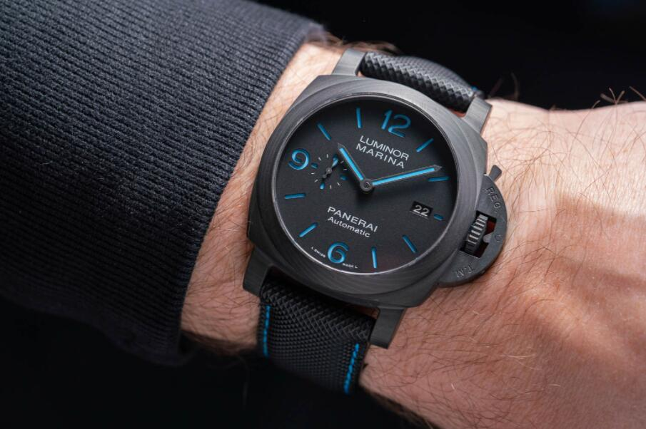 The black dial fake watch has a black strap.