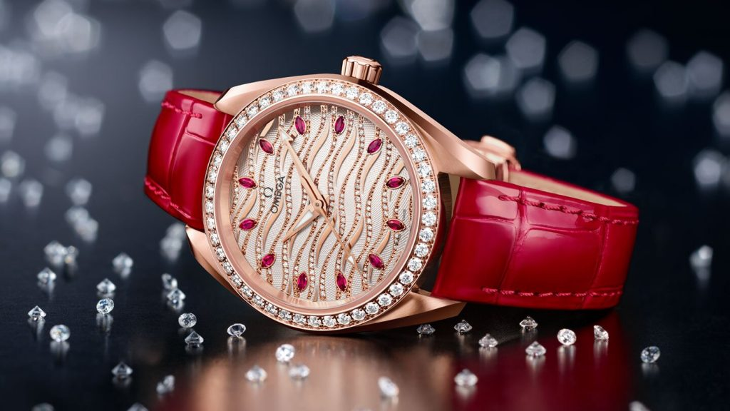 The red strap fake watch is decorated with diamonds.