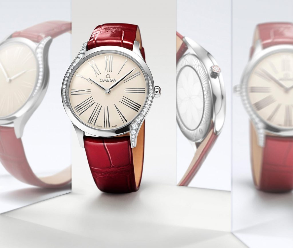 The red strap fake watch has a silvery dial.